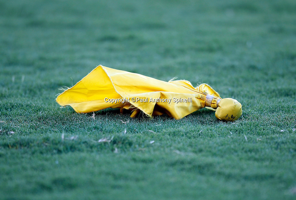 A penalty flag lies on the grass during the San Diego Chargers NFL week 2 preseason football game against the Dallas Cowboys on Saturday, August 21, 2010 in San Diego, California. The Cowboys won the game 16-14. (©Paul Anthony Spinelli)