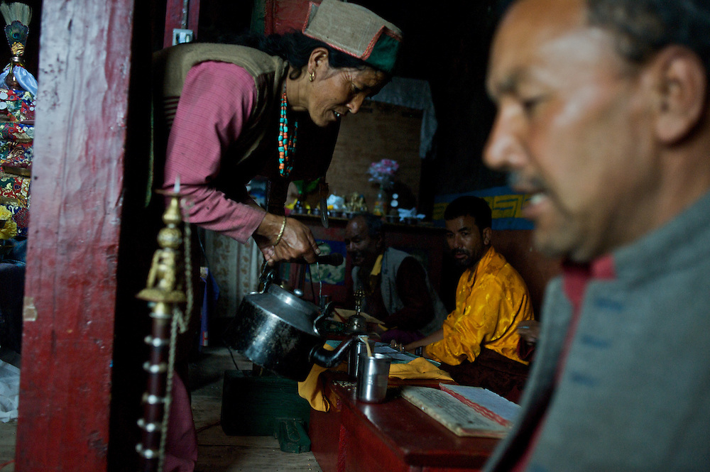 A woman pours milk tea during a prayer ceremony at Giabong Monastery in Ropa Valley, Himachal Pradesh, India.