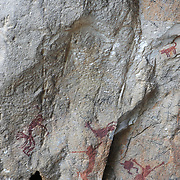 Prehistoric cave paintings at Khao Pla Ra, Uthai Thani in Thailand. The cave is on a limestone Karst at the height of 320 metres. They are approx 3,000 years-old. The paintings are drawn with black and red lines. The paintings were drawn along the cliff for a total distance of about 9 metres,  The pictures depict the way of life of ancient humans, and are an important historical heritage of Uthai Thani.