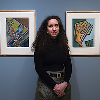 VENICE, ITALY - JANUARY 28:  Vivien Greene, Curator of 19th- and Early 20th-Century Art at the Guggenheim Museum New York poses in front of two  exhibits at the press launch of the Vorticist exhibition on January 28, 2011 in Venice, Italy. The Vorticists: Rebel Artists in London and New York, 1914-1918, is the first exhibition devoted to Vorticism to be presented in Italy will be open at the Peggy Guggenheim Collection from  January 29 through May 15, 2011.