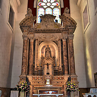 Altar of Iglesia de San Pedro Claver in Old Town, Cartagena, Colombia<br /> This exquisite marble altar with a broken pediment adorns the nave of Iglesia de San Pedro Claver. The Catholic church's namesake is a Spanish Jesuit monk.  He was tireless advocate for slaves during the first half of the 17th century.  Known as the Apostle of the Blacks, Peter Claver was canonized in 1888. The saint's remains are buried in a gilded crypt at the base of the altar.
