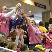 Delaware fans wearing pink t-shirts attempts to catch flying t-shirts in the second half of a NCAA regular season Colonial Athletic Association conference game between Delaware and The Towson Tigers Sunday, Feb 16, 2014 at The Bob Carpenter Sports Convocation Center in Newark Delaware.