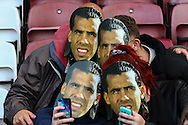 West Ham United fans wearing Carlos Tevez masks before the Capital One Cup match at the Boleyn Ground, London<br /> Picture by David Horn/Focus Images Ltd +44 7545 970036<br /> 26/08/2014