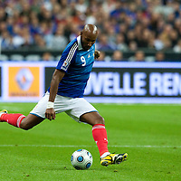 05 September 2009: French forward Nicolas Anelka kicks the ball during the World Cup 2010 qualifying football match France vs. Romania (1-1), on September 5, 2009 at the Stade de France stadium in Saint-Denis, near Paris, France.