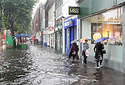CHISWICK HIGH STREET AND TURNHAM GREEN TERRACE CHISWICK WEST LONDON ARE FLOODED IN A TROPICAL DOWNPOUR.20.7.07.PIX STEVE BUTLER