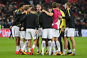 Tottenham Hotspur players in a huddle during the Champions League match between Tottenham Hotspur and Real Madrid at Wembley Stadium, London, England on 1 November 2017. Photo by Matthew Redman.