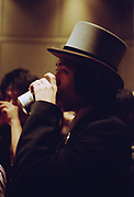 Man in a top hat drinking a can of beer, Japan, 2003