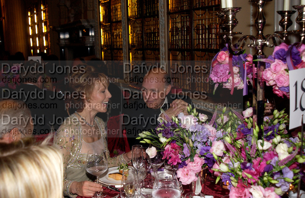 Lady Victoria Getty and Reinaldo Herrera, Ball at Blenheim Palace in aid of the Red Cross, Woodstock, 26 June 2004. SUPPLIED FOR ONE-TIME USE ONLY-DO NOT ARCHIVE. © Copyright Photograph by Dafydd Jones 66 Stockwell Park Rd. London SW9 0DA Tel 020 7733 0108 www.dafjones.com