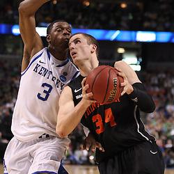 Mar 17, 2011; Tampa, FL, USA; Princeton Tigers forward Ian Hummer (34) drives past Kentucky Wildcats forward Terrence Jones (3) during second half of the second round of the 2011 NCAA men's basketball tournament at the St. Pete Times Forum. Kentucky defeated Princeton 59-57.  Mandatory Credit: Derick E. Hingle