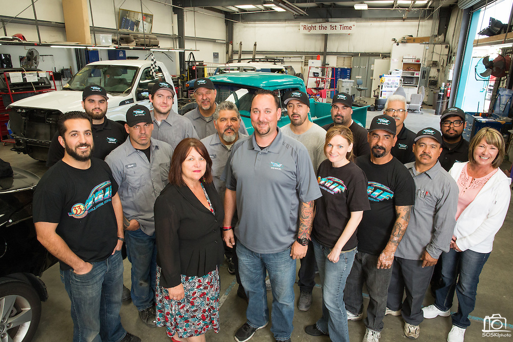 The T.G.I.F. Body Shop, Inc., team poses for a photo at T.G.I.F. Body Shop, Inc., in Fremont, California, on April 17, 2014. (Stan Olszewski/SOSKIphoto)