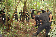 XISHUANGBANNA, CHINA - OCTOBER: 17 (CHINA OUT) <br /> <br /> An Elephant Is beheaded in Yunnan province of China<br /> <br /> Policemen carry corpse of a dead elephant at Mengla conservation area on October 17, 2014 in Xishuangbanna, Yunnan province of China. A male Asian elephant was killed by being beheaded with its ivories taken away near Mengla County. Local police station returns attractive money for people who give clues to catch the criminals.<br /> ©Exclusivepix