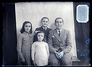 family group studio portrait France circa 1930s