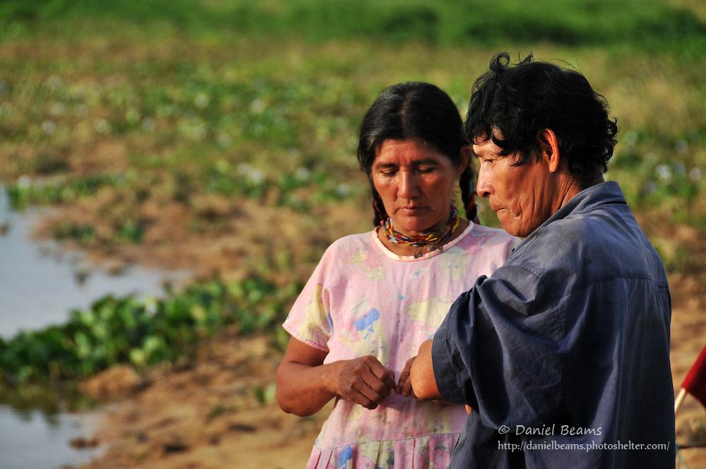 Chimani couple on river near San Lorenzo de Moxos, Beni, Bolivia