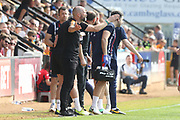 Joe Dunne and the Cambridge bench react to a decision during the EFL Sky Bet League 2 match between Cambridge United and Cheltenham Town at the Cambs Glass Stadium, Cambridge, England on 21 April 2018. Picture by Antony Thompson.