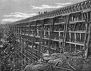 Union Pacific Railroad: Wooden trestle bridge at Dale Creek. All timber used in construction had to be hauled 1,000 miles from Chicago. Woodcut, 1869