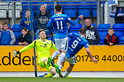 Mark Gillespie (#20) of Motherwell FC makes a save from Chris Kane (#9) of St Johnstone FC, as Danny Swanson (#11) of St Johnstone FC watches on during the Ladbrokes Scottish Premiership match between St Johnstone and Motherwell at McDiarmid Stadium, Perth, Scotland on 11 May 2019.