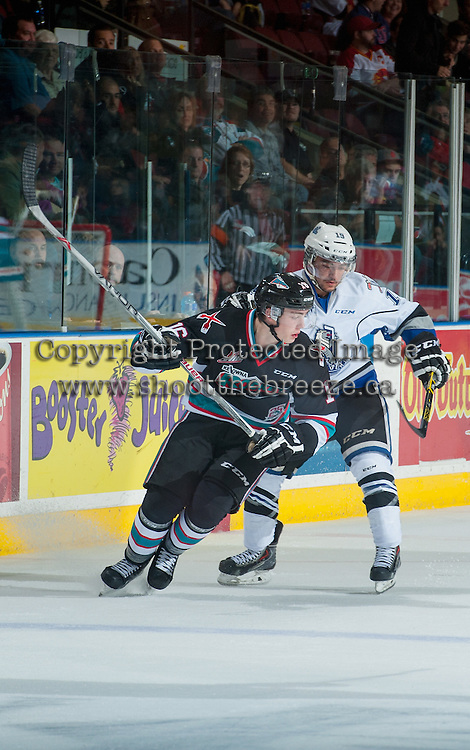 KELOWNA, CANADA - OCTOBER 9: Kole Lind #16 of Kelowna Rockets is checked by a player of the Victoria Royals on OCTOBER 9, 2015 at Prospera Place in Kelowna, British Columbia, Canada.  (Photo by Marissa Baecker/Getty Images)  *** Local Caption *** Kole Lind;