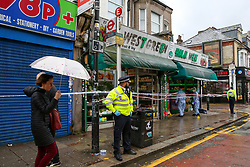© Licensed to London News Pictures. 13/10/2019. London, UK. The scene outside West Green Halal Meat and Groceries store on West Green Road in Tottenham, North London where two men were stabbed and rushed to hospital shortly after 9.30am this morning. The ages of the two victim and their condition is not yet know. Photo credit: Dinendra Haria/LNP