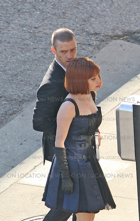 """Los Angeles, CA. December 13th 2010  Non Exclusive. Justin Timberlake returns to work filming his movie """"NOW"""" after the production shut down due to an ankle injury Timberlake suffered on set last week. Actress Amanda Seyfried was also on set with Justin and the pair appeared to have geat chemistry together on and off camera. After a scene with a gun was finished Amanda jokingingly took the gun from Justin and pointed it at his crotch. Justin seemed bothered by his injury at one point when he was seen removing  his shoe and sock to re wrap support on his ankle. Photo by Eric Ford 818-613-3955 onlocationnews@att.net"""