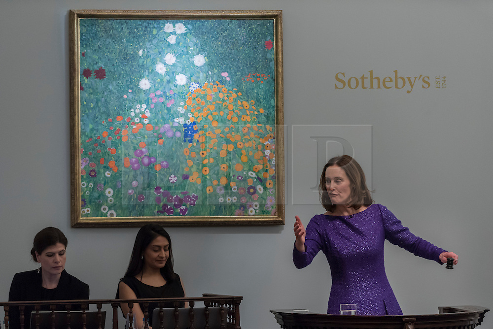 "© Licensed to London News Pictures. 01/03/2017. London, UK. ""Bauerngarten (Blumengarten)"" by Gustav Klimt sold for a hammer price of GBP42.5m, at the evening sale of Impressionist and Surrealist Art at Sotheby's in New Bond Street. Photo credit : Stephen Chung/LNP"