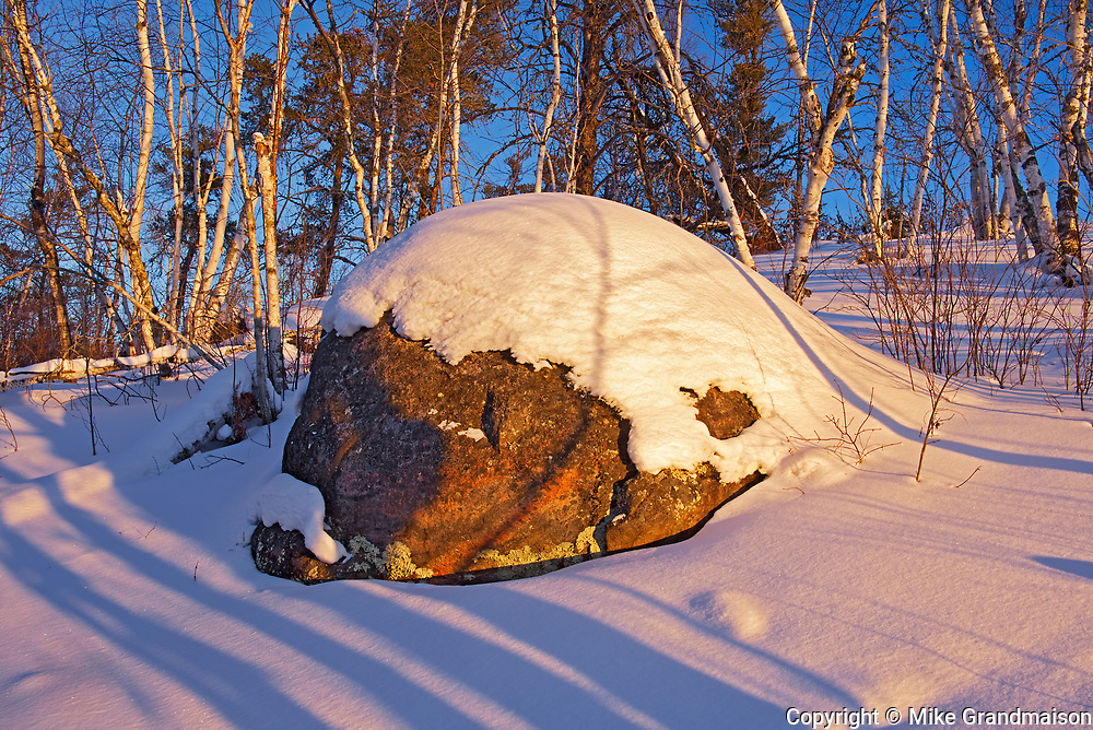 Morning light on snow and rock at Caddy Lake<br />Whiteshell Provincial Park<br />Manitoba<br />Canada