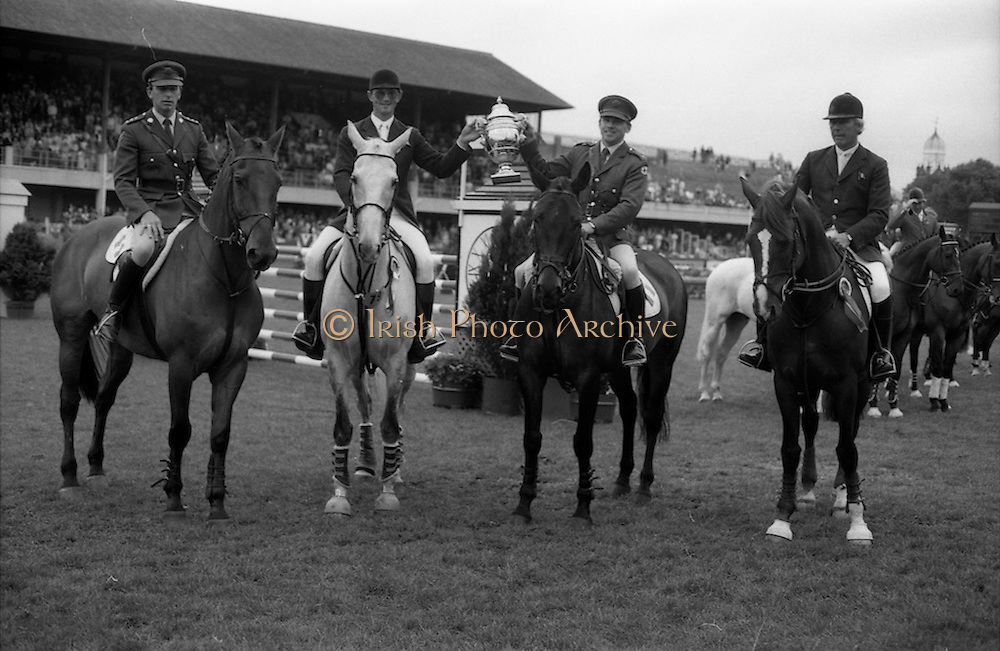 "07/08/1987<br /> 08/07/1987<br /> 07 August 1987<br /> Bank of Irelands Nations Cup for the Aga Khan trophy competition at the Dublin Horse Show at the RDS, Dublin. The winning Irish team proudly hold aloft the Aga Khan Trophy after their victory. Pictured (l-r):  Captain John Ledingham on ""Gabhran""; Jack Doyle on ""Hardly""; Commandant Gerry Mullins, on ""Limerick"" and Eddie Macken on ""Carroll's Flight""."