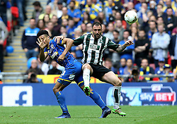 Peter Hartley of Plymouth Argyle beats Lyle Taylor of AFC Wimbledon to the ball - Mandatory by-line: Robbie Stephenson/JMP - 30/05/2016 - FOOTBALL - Wembley Stadium - London, England - AFC Wimbledon v Plymouth Argyle - Sky Bet League Two Play-off Final