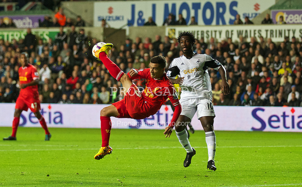 SWANSEA, WALES - Monday, September 16, 2013: Liverpool's Philippe Coutinho Correia in action against Swansea City during the Premiership match at the Liberty Stadium. (Pic by David Rawcliffe/Propaganda)
