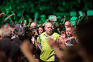 Michael van Gerwen walks through the fans for his match against Peter Wright in the Betway Premier League Darts at the Brighton Centre in Brighton, East Sussex. PRESS ASSOCIATION Photo. Picture date: Thursday 15th May, 2014. Photo credit should read: Chris Ison/PA Wire.