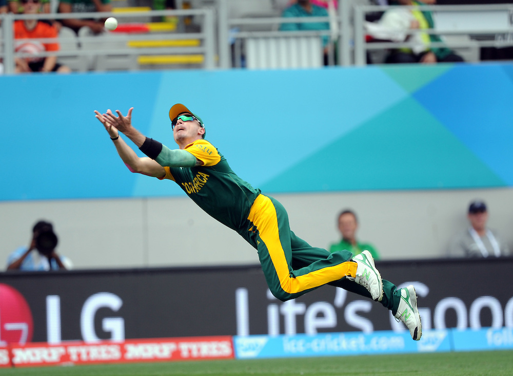 South Africa's Dale Steyn makes a diving catch to dismiss Pakistan's Ahmed Shehzad for 18 in the ICC Cricket World Cup at Eden Park, Auckland, New Zealand, Saturday, March 07, 2015. Credit:SNPA / Ross Setford