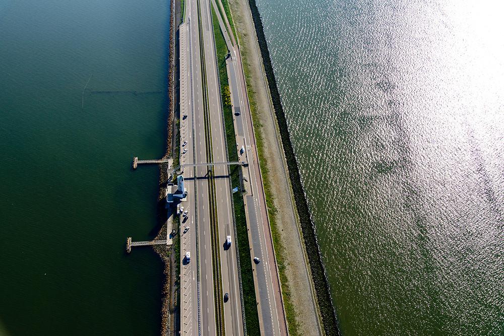 Nederland, Noord-Holland, Den Oever, 07-05-2018; Afsluitdijk met Vlietermonument. Het Monument is verrezen op de plaats - de Vlieter - waar het laatste gat in de Afsluitdijk in 1932 gesloten werd. Noord-Holland aan de verre horizon. IJsselmeer links in beeld.<br /> Enclosure Dam with Monument. Waddenzee (right).<br /> <br /> luchtfoto (toeslag op standard tarieven);<br /> aerial photo (additional fee required);<br /> copyright foto/photo Siebe Swart