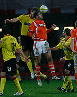 Photo: Richard Lane/Richard Lane Photography. Watford v Blackpool. Coca Cola Championship. 01/11/2008. Ben Burgess (R) and Darren Ward (L) challange in the penalty area