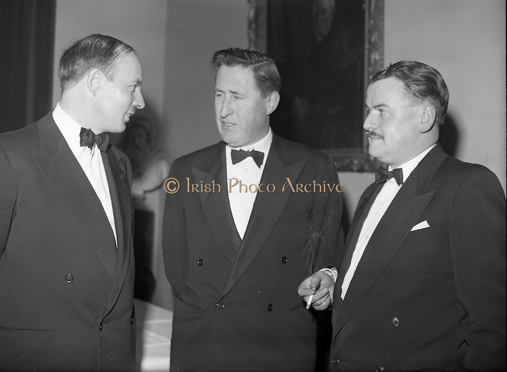 20/2/1959<br /> 02/20/1959<br /> 20 February 1959<br /> <br /> Mr Donal Ó Móráin of Gail Linn Minister for Local Goverment Kevin Boland and unnamed gentelman on the right at the Cunmann Gaelach Inaugural