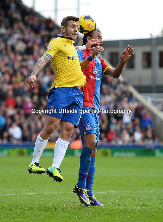 26th October 2013 - Barclays Premier League  - Crystal Palace v Arsenal - Jack Wilshere of Arsenal in action with former team mate Marouane Chamakh of Crystal Palace - Photo: Marc Atkins / Offside.