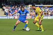 AFC Wimbledon defender George Francomb (7) taking on Bristol Rovers striker Byron Moore (22) during the EFL Sky Bet League 1 match between AFC Wimbledon and Bristol Rovers at the Cherry Red Records Stadium, Kingston, England on 8 April 2017. Photo by Matthew Redman.