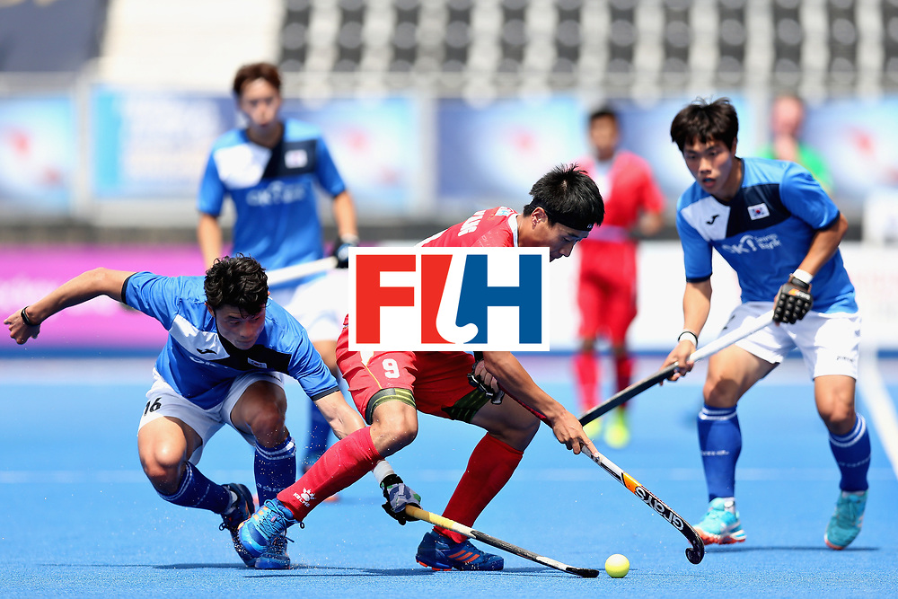 LONDON, ENGLAND - JUNE 17: Yang Ao of China battles for the ball with Jongsuk Bae of South Korea  during the Hero Hockey World League Semi Final match between China and Korea at Lee Valley Hockey and Tennis Centre on June 17, 2017 in London, England.  (Photo by Alex Morton/Getty Images)