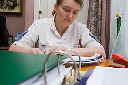Nurse reading nursing journals at home,