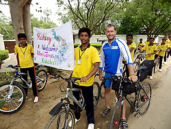 © Licensed to London News Pictures. 19/08/2013. Bangalore, Karnataka, India. James Ketchell world cycle/ global triathlon.  Anjana Vidya Kendra School, Bangalore - on riding to this school flanked by students one right in front of James had a crash which resulted in James and then all the students behind piled up in a big tangled mess. The previous parts of this incredible and unique series were an Atlantic solo row in 2010 and summiting Everest in 2011.Photo credit : James Ketchell/LNP