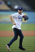 LOS ANGELES, CA - AUGUST 22:  Actor  Jesse Tyler Ferguson, co-star of the comedy television series Modern Family, has some fun as he gets ready to throw out the celebratory first pitch before the Los Angeles Dodgers game against the New York Mets at Dodger Stadium on Friday, August 22, 2014 in Los Angeles, California. The Dodgers won the game 6-2. (Photo by Paul Spinelli/MLB Photos via Getty Images) *** Local Caption *** Jesse Tyler Ferguson