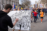 An artist painting at the Put It To The People march for a Peoples Vote on 23rd March 2019 in London, United Kingdom. With less than one week until the UK is supposed to be leaving the European Union, the final result still hangs in the balance and protesters gathered in their hundreds of thousands to make political leaders take notice and to give the British public a vote on the final Brexit deal. (photo by Andrew Aitchison / In Pictures via Getty Images)