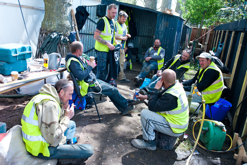 London, UK - 16 May 2013: workmen in a moment of relax during the preparations for the RHS Chelsea Flower Show 2013 edition