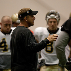 08 August 2009: Saints head coach Sean Payton talks to players before the New Orleans Saints annual training camp Black and Gold scrimmage held at the team's indoor practice facility in Metairie, Louisiana.