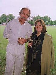 MR & MRS ROGER UTTLEY the former English Rugby coach, at a cricket match in London on 14th June 1999.MTE 33