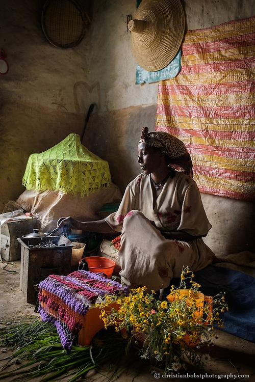 Beles Sunrise project BSP, water harvesting & irrigation. Take´en Weldegebriel (38), preparing coffee. (traditional ethiopian coffee ceremony).