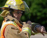 © 2008 Randy Vanderveen, all rights reserved.Grande Prairie, Alberta.Captain Bart Johnson keeps time as Grande Prairie firefighters train in Muskoseepi Park by conducting some Performance Standard Drills during the mid-day hours of a summer day.
