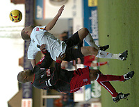 Photo: Ian Hebden.<br />Luton Town v Stoke City. Coca Cola Championship.<br />17/12/2005. <br />Stoke's Michael Duberry (L) challenges with Luton's Rowan Vine.