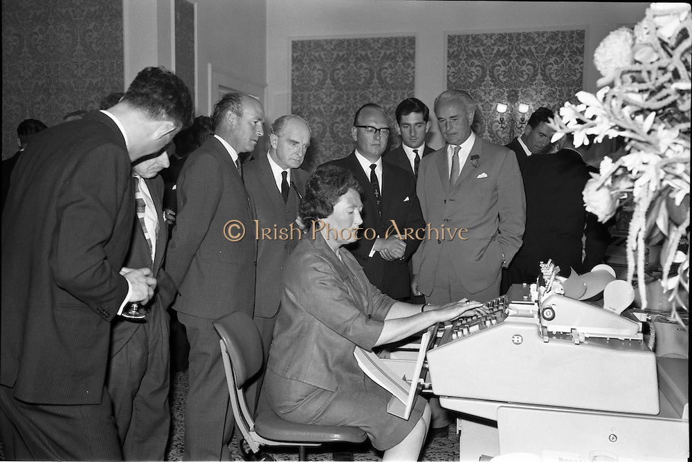 18/06/1963.06/18/1963.18 June 1963.Opening of Burroughs Business Efficiency Exhibition at the Royal Hibernian Hotel, Dublin. The exhibition displayed various models of Burroughs management machines. The highlight was the F4000 Electronic Accounting System - The Sensitronic.  .Watching Miss E.M. Walshe, Chief Demonstrator in Ireland, operating the F4000 Electronic Accounting System - The Sensitronic, are: Mr. M.J. Dargan, Assistant General Manager, Aer Lingus; Mr. John O'Brien, Arthur Rae, O'Brien and Co., public relations; Mr. J. Geddes, Burroughs General Manager for Ireland and Mr. C. Gore-Grimes, Senior Partner, Gore and Grimes.