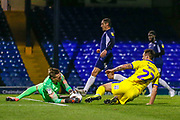 AFC Wimbledon forward Tommy Wood (22) clashes with Southend United goalkeeper Nathan Bishop (13) during the EFL Trophy match between Southend United and AFC Wimbledon at Roots Hall, Southend, England on 13 November 2019.