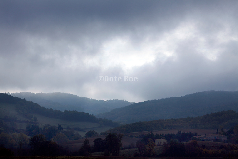 dark clouds over mountain landscape