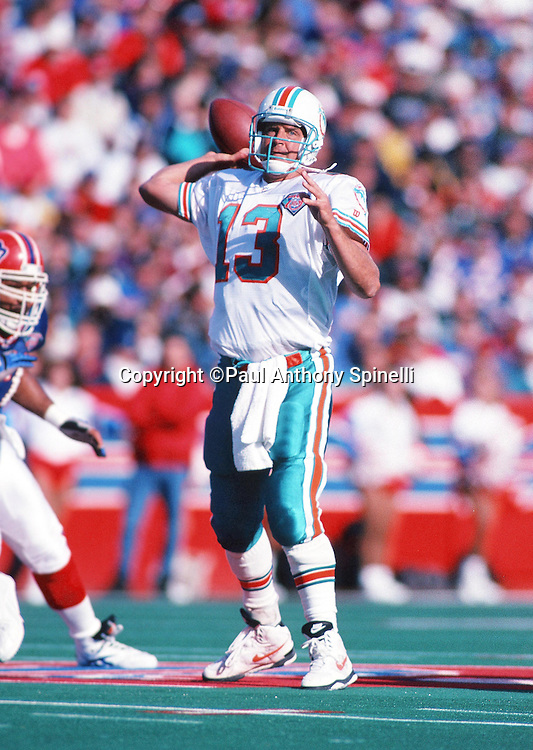 Miami Dolphins quarterback Dan Marino (13) throws a pass during the NFL football game against the Buffalo Bills on Oct. 9, 1994 in Orchard Park, N.Y. The Bills won the game 21-11. (©Paul Anthony Spinelli)